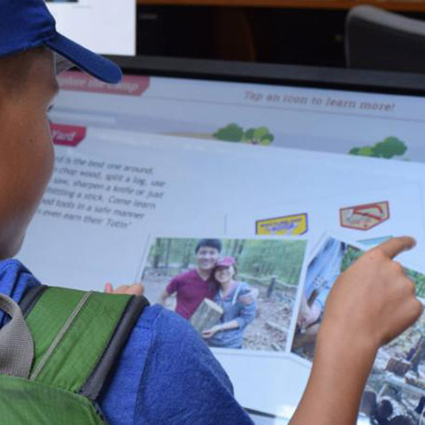 Boy Scout using touchscreen